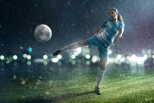 Soccer woman shooting ball