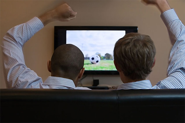 Men watching soccer on television