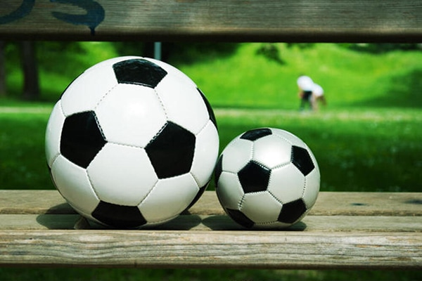 two different soccer ball sizes